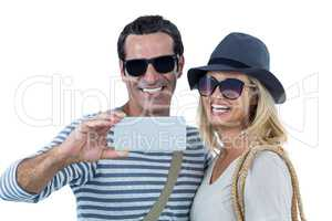 Mid adult couple smiling while taking selfie