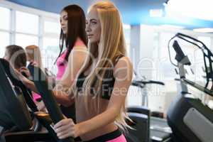 Beautiful girls training endurance at gym