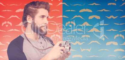 Composite image of hipster using digital camera