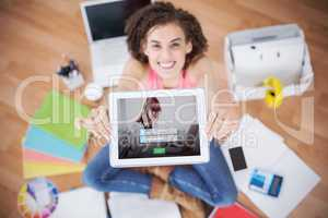 Composite image of login screen with redheaded woman and laptop