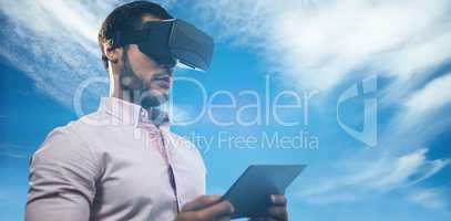 Composite image of low angle view of businessman holding virtual