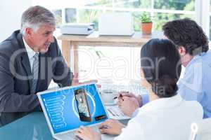 Composite image of business people in discussion in an office