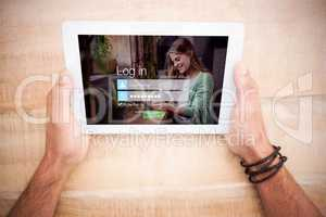 Composite image of login screen with smiling woman with pad and