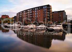 Horizontal vivid Norway yachts in city reflection background bac