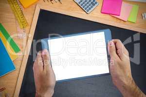 Composite image of chalkboard on desk