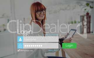 Log-in screen with redheaded woman and pad device