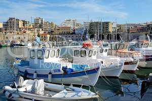 The traditional Greek fishing boat are near pier, Heraklion, Greece