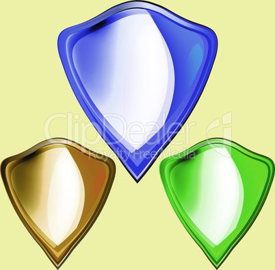 Shield Icon. Set of colored metal bulk shields, gold, green, blue