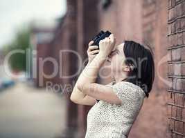 Girl taking photo outdoors