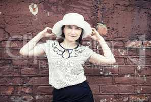 Posing woman in hat