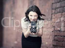 Woman taking photo outdoors