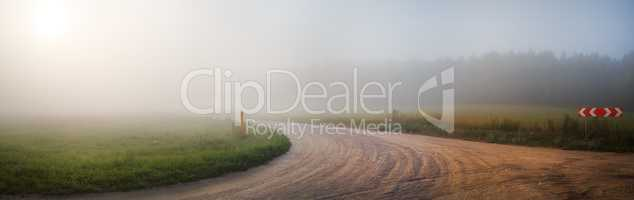 Gravel road and fog