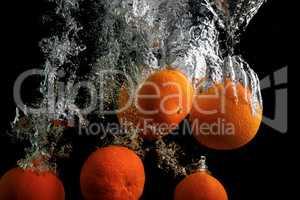 Tangerines in water