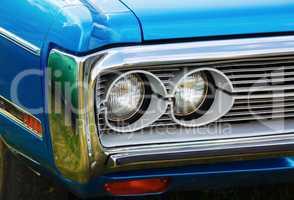 Headlights of blue car