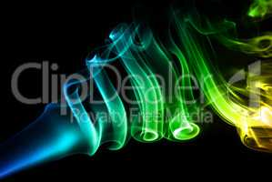Multicolored smoke on black
