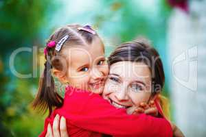 Embrace mom with daughter