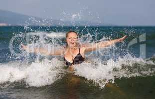 Woman in wave