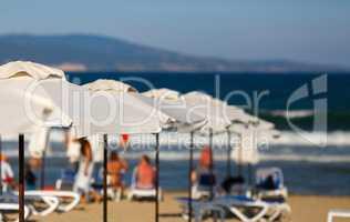 Blurred beach parasols