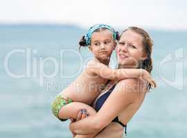 Mom holds little daughter