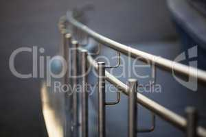 Chrome fence with handrail