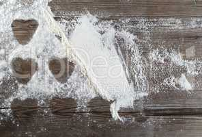 Flour on a wooden background
