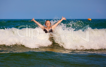 Girl and sea wave
