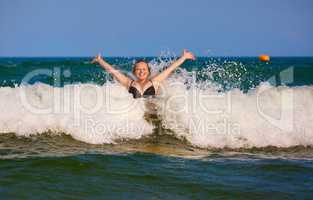Girl and sea wave