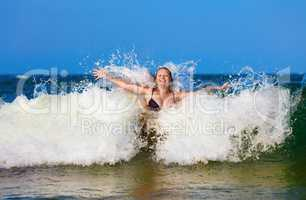 Woman in sea wave