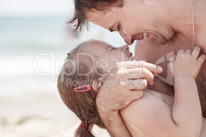 Dad and daughter laughing