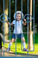 Child behind a fence