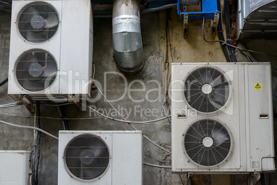 Group of air conditioner units outside building