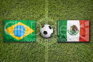 Brazil vs. Mexico flags on soccer field
