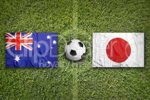 Australia vs. Japan flags on soccer field