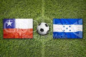 Chile vs. Honduras flags on soccer field