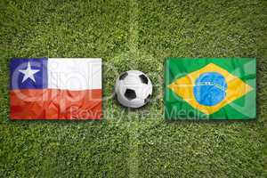 Chile vs. Brazil flags on soccer field