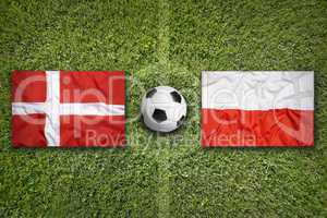 Denmark vs. Poland flags on soccer field