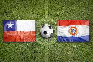 Chile vs. Paraguay flags on soccer field