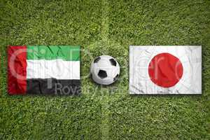 United Arab Emirates vs. Japan flags on soccer field
