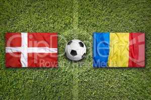 Denmark vs. Romania flags on soccer field