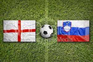 England vs. Slovenia flags on soccer field