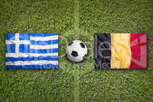 Greece vs. Belgium flags on soccer field