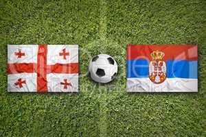 Georgia vs. Serbia flags on soccer field