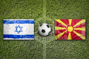 Israel vs. Macedonia flags on soccer field