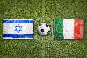 Israel vs. Italy flags on soccer field