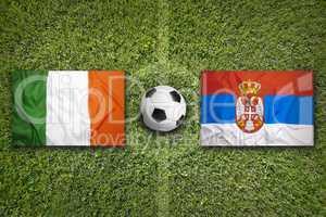 Ireland vs. Serbia flags on soccer field
