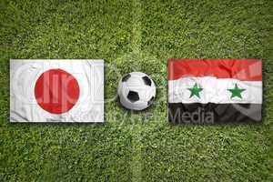 Japan vs. Iraq flags on soccer field