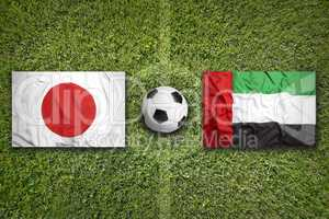 Japan vs. United Arab Emirates flags on soccer field