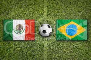 Mexico vs. Brazil flags on soccer field