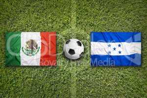 Mexico vs. Honduras flags on soccer field