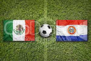 Mexico vs. Paraguay flags on soccer field